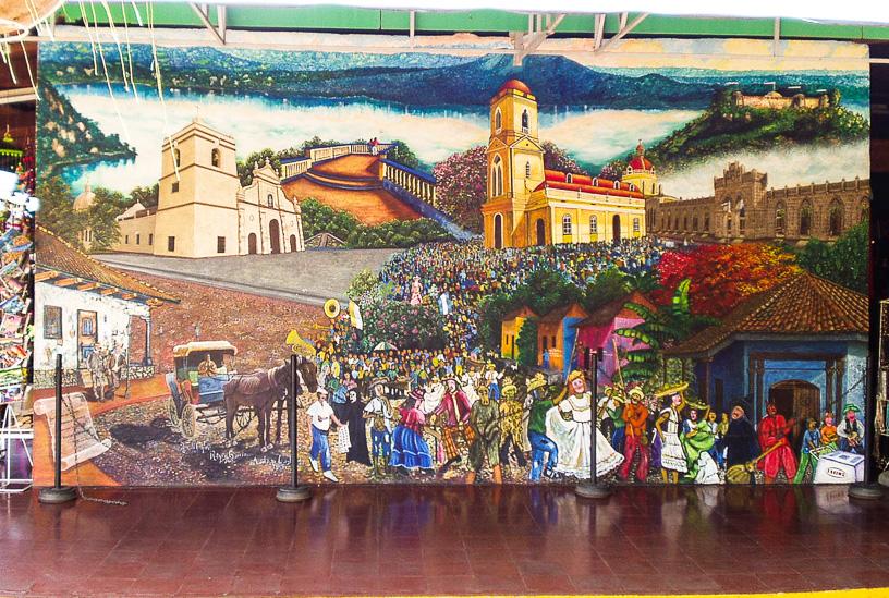 Mural en el Mercado de Artesanias de Masaya, muestra el mirador de la Laguna de Masaya, la iglesia del parque central, fiestas tradicionales de máscaras y varios aspectos típicos de la ciudad.